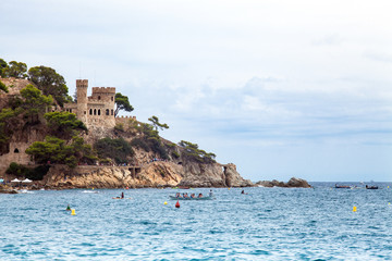 Castell d'en Plaja on the Costa Brava in Lloret de Mar, Spain. View of the Balearic Sea and the rocky coast. Popular tourist destination in Spain.