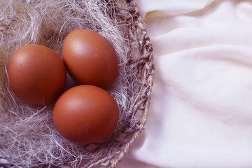 Easter basket in the form of a bird's nest with Easter eggs