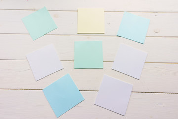 Many square sheets of paper pinned to wooden boards. White-painted surface in a rustic style. Background with copy space
