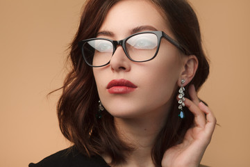 Beautiful woman in black rimmed spectacles