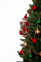 Christmas tree with toys and Santa Claus isolated on white background