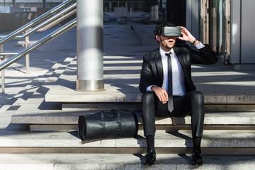 afro businessman playing virtual reality simulation