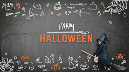 Happy halloween with girl kid in witch costume riding broomstick on spooky dark black chalkboard with chalk doodle of trick or treat candies and scary ghost for holiday greeting festival celebration