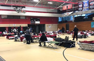 People seen in the hurricane shelter set up in the Belle Chasse High School gym