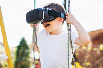 Little boy having fun playing with virtual reality headset