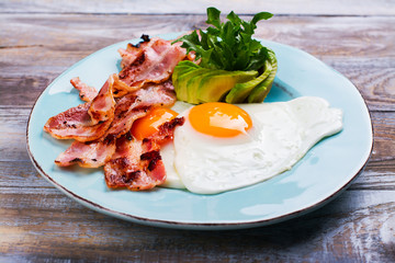 Aluminium Prints Egg Continental breakfast with fried eggs, bacon and avocado. Ketogenic diet concept. Space for text