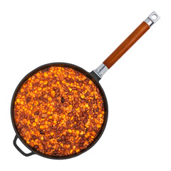 Hot chili con carne in a cast iron pan isolated on white background, top view