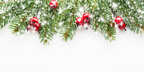 Christmas and New Year holiday background. Xmas greeting card. Snow effect. Spruce tree on white background.