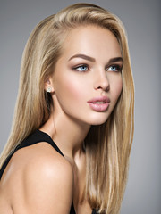 Beautiful young woman with long  straight  hairs