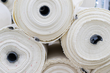 the fabric on the jeans factory. material for clothes in rolls