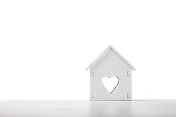 white house model icon with heart symbol