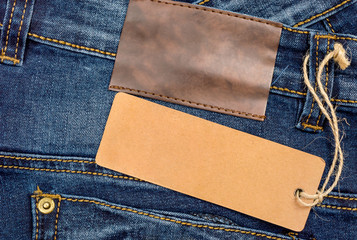 Blue jeans with blank paper label.