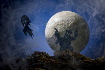 Halloween, ghosts against the background of the big moon