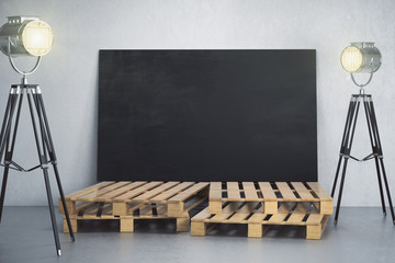 Room with empty blackboard banner and lighting