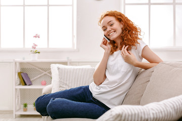 Smiling young girl calling on mobile phone