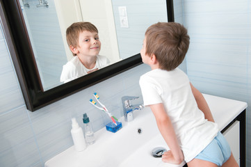 happy smiling little kid in blue bathroom