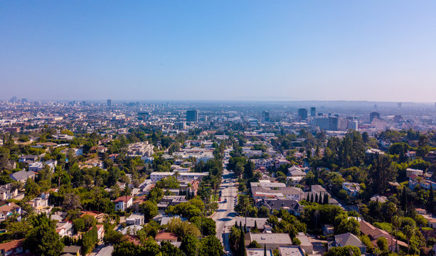 Panoramic aerial view on the Los Angeles from above. Clear blue sky. Hollywood sign district area