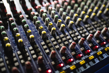 Close up footage of audio mixer. Sound control panel at concert