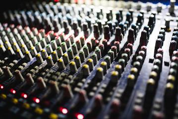 Close up footage of audio mixer. Sound control panel at concert