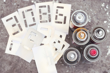 five spray cans with stencil numbers