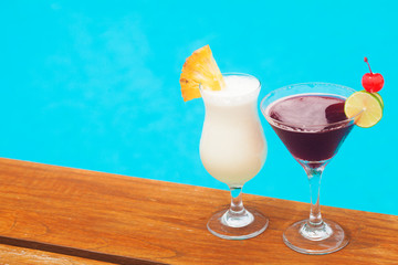 two delicous cocktails by the pool