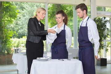 Manager instructing restaurant waiters