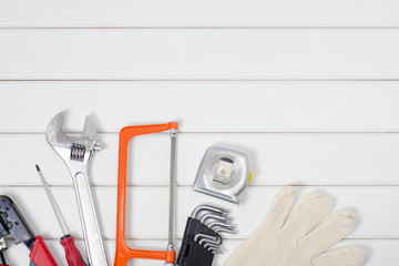 Tools on a white wooden background