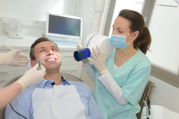 female dentists working on young male patient dentists office