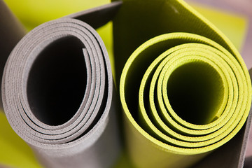 Colorful yoga. Modern exercise style. Gym background, bright gymnastics mats top view closeup, fitness concept