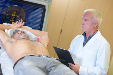 doctor performing test on male patient