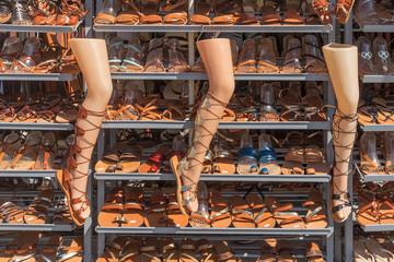 Shop window with women's handmade sandals, traditional Greek product. Perissa, Santorini, Greece