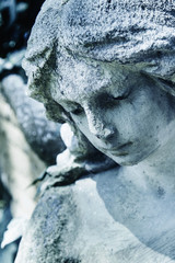 Antique statue of angel Cherub as symbol of human security