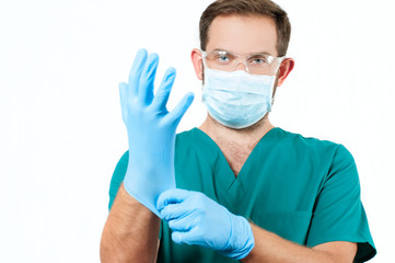 Male Doctor with stethoscope and protective mask and gloves.