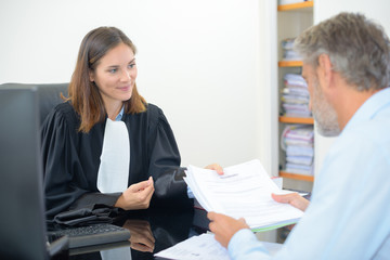 Man in meeting with female lawyer