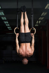 Muscular Man Hold Gymnastic Rings
