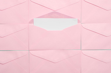 Pink envelope with blank white card