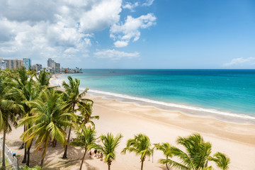 Beach travel Caribbean vacation landscape of Puerto Rico background. Isla Verde in San Juan, Latin America island.