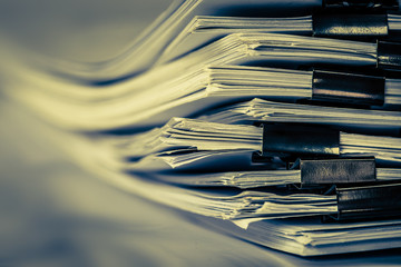 extremly close up  stacking of office working document with paper clip folder, vintage color tone