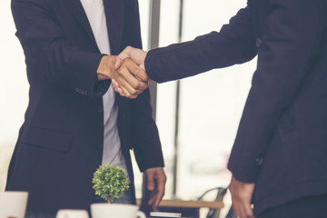Concept of partnership - handshake business partners.Trust business.