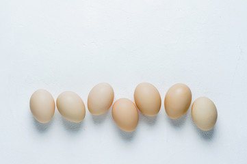 Chicken eggs on a white background. Flat lay and top view