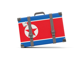 Luggage with flag of korea north. Suitcase isolated on white