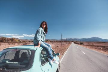 Girl enjoying road trip