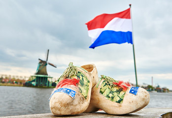 holland. Wooden shoes netherland flag and windmill in zaanse schans Fototapete