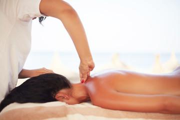 Spa Woman. Brunette Getting a Marine Algae Wrap Treatment in Spa