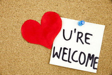 You Are wellcome sign written on sticky note pinned on pinboard with rd heart