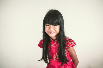A cute asian kid girl wearing red Chinese dress for Chinese New year