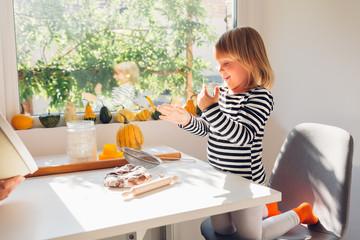 Happy little girl making cakes