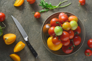 Ripe tomatoes on a stone table kitchen surface, top view
