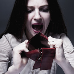 Beautiful business woman with empty wallet