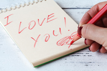 I Love You word on notebook page
